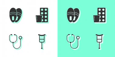 Set Crutch or crutches, Slippers, Stethoscope and Pills in blister pack icon. Vector. icon
