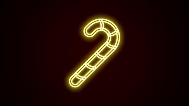 Zářící neon line Vánoční cukrová třtina s pruhy ikona izolované na černém pozadí. Šťastný Halloweenský večírek. Grafická animace pohybu videa 4K