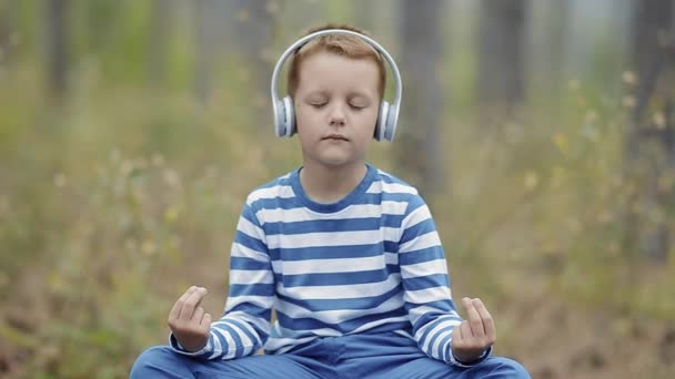 Cute Little Boy Meditating In The Forest