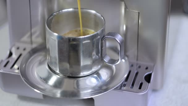 Coffee maker fills cup of coffee