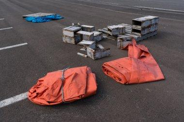 Orange tarp and broken boxes