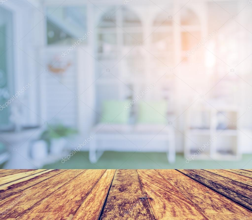 Empty wood table and blurred living room background stock photo - Empty Wood Table And Blurred Living Room Background Photo By Coffmancmu