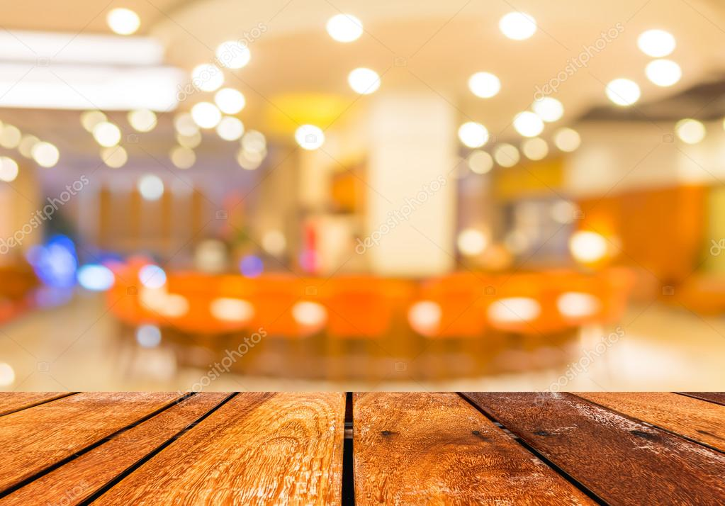 Empty wood table and Coffee shop blur background with ...