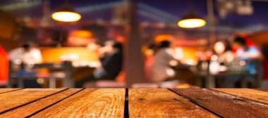 empty brown wooden table and  Coffee shop blur background with bokeh image