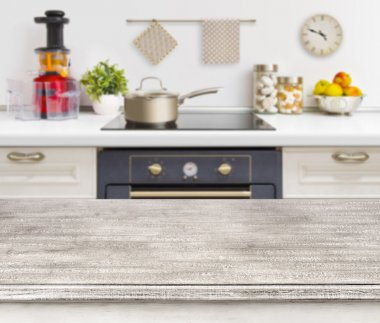 Wooden table on defocused kitchen bench with oven background