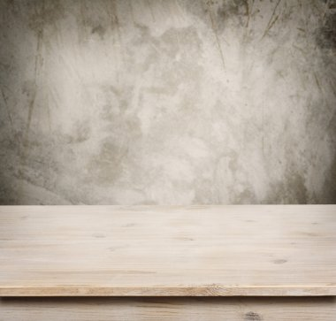 Wooden table on defocuced vintage wall background