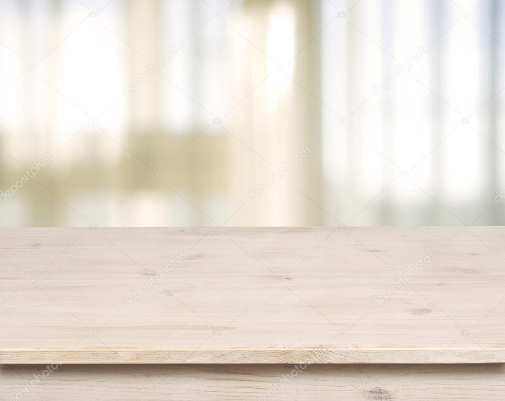 Wooden table on defocuced window with curtain background ...