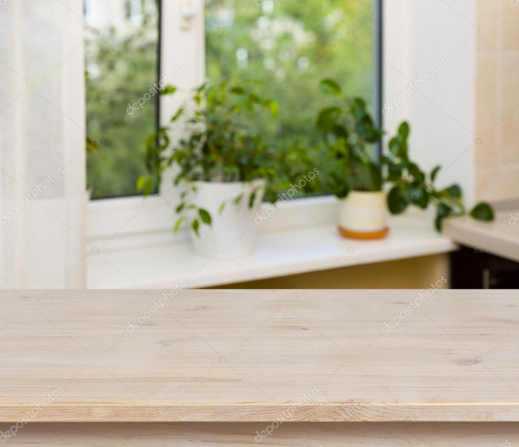 Wooden table on window background — Stock Photo © didecs ...