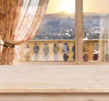 Wooden table on blurred balcony window background
