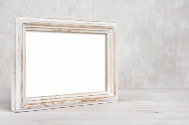 Old painted photo frame on table over abstract background stock vector
