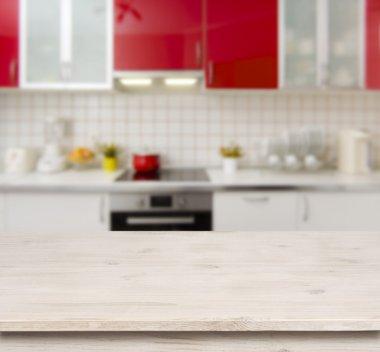 Wooden table on red modern kitchen bench interior background