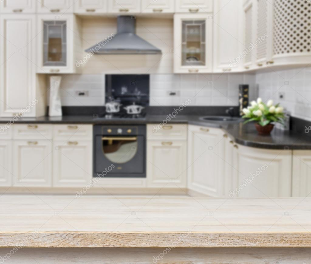 Kitchen Background Image: Wooden Textured Table Over Blurred Kitchen Interior