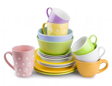 Stack of colorful plates and cups isolated on white background