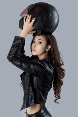 Beautiful female biker wearing a leather jacket