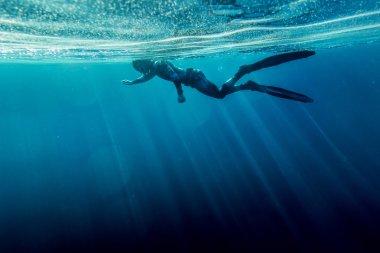 Freediver swim in the sea