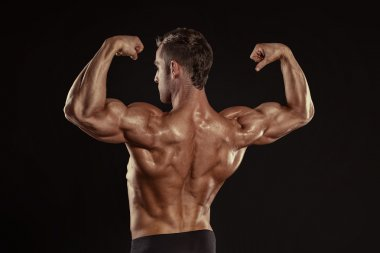 Athletic Man posing back muscles, triceps,