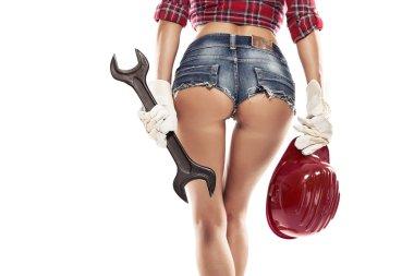 Sexy woman mechanic showing  bum buttock