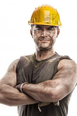 Dirty worker with helmet crossed arms