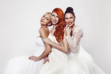 Three beautiful woman in wedding dress