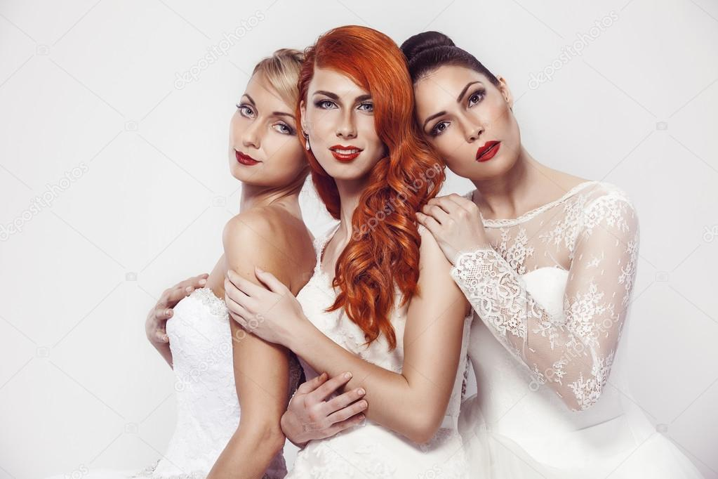 Three beautiful woman in wedding dress