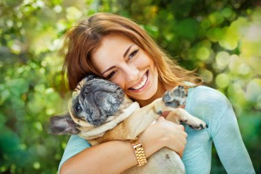 Happy woman with french bulldog