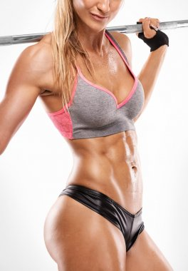Nice sexy woman showing abdominal muscles, closeup, workout with big dumbbell