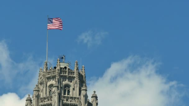 United States of America Flag Waving on the Top of a Skyscraper