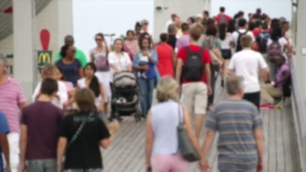 Crowd Crossing Maremagnum Marketplace Bridge in Barcelona Blurred