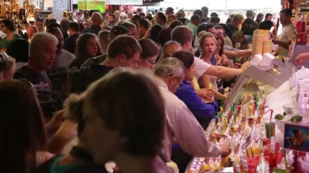 Crowd Shopping in La Boqueria Market in Barcelona.