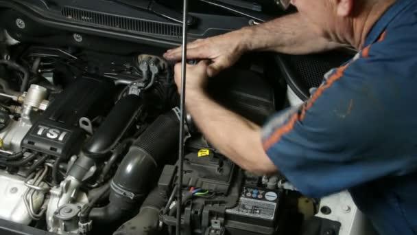 Car Repair Mechanic Screwing Automobile Air Filter