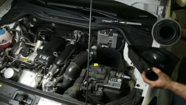 Car Repair Mechanic Assembles Automobile Air Filter