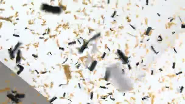 Konfety dopadající na bílé zdi a mizí černá