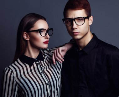 Eyewear concept. Portrait of gorgeous fashion couple in black cl