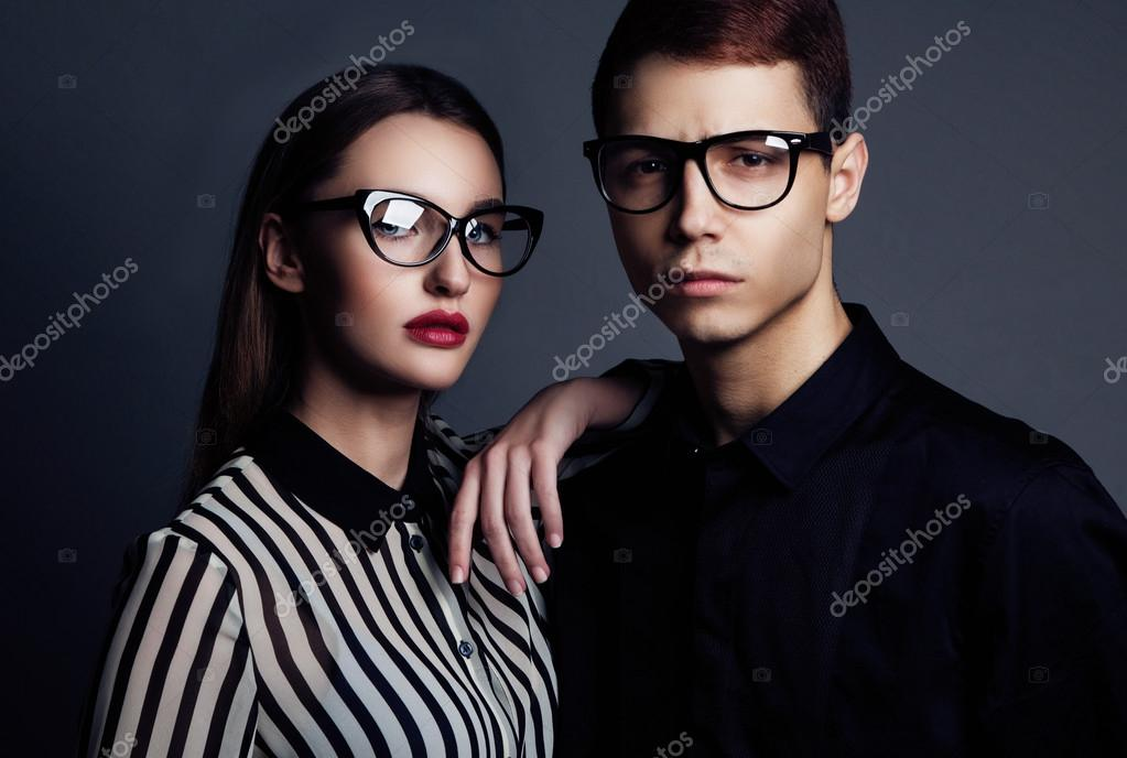 Fashion models couple wearing sunglasses sexy woman and handsom stock photo