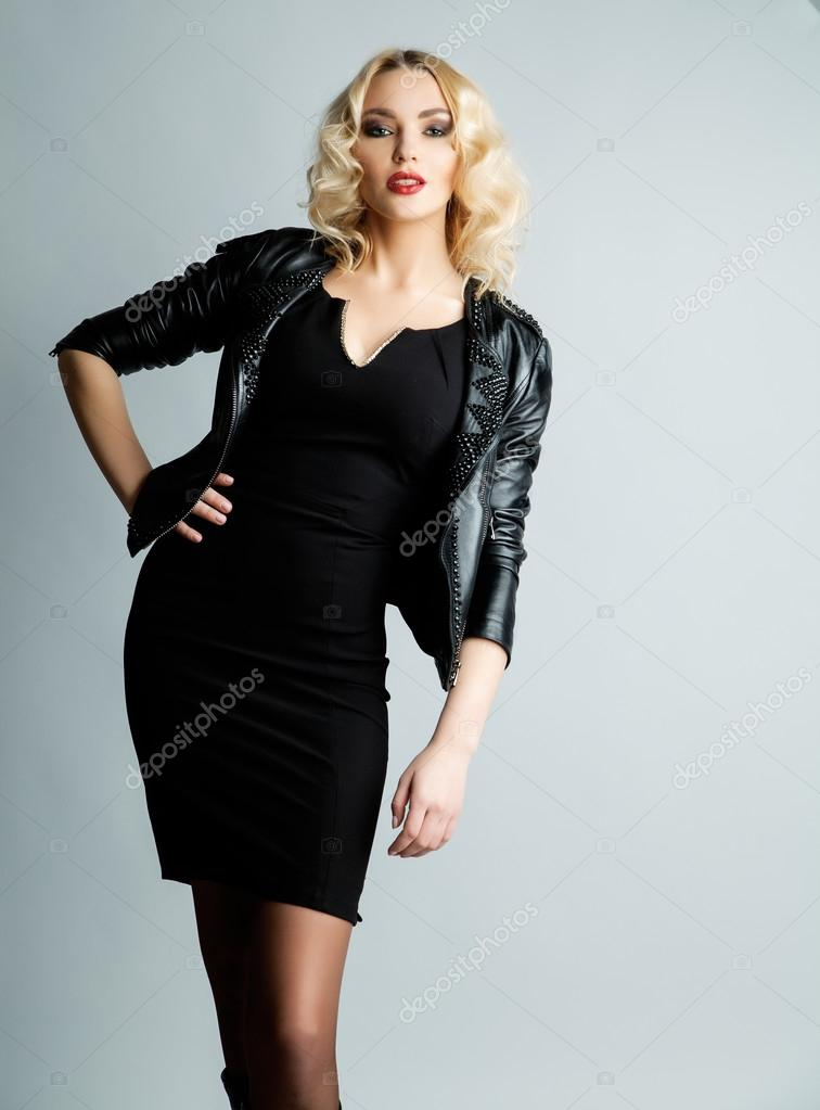 d47d9097f42 Glamour blond woman in leather jacket and black dress over grey ...