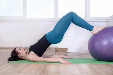 Girl doing abdominal muscles of her body.