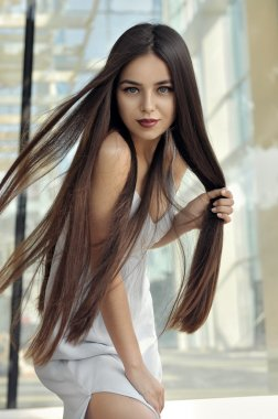 Beautiful girl with flying hair in the wind.