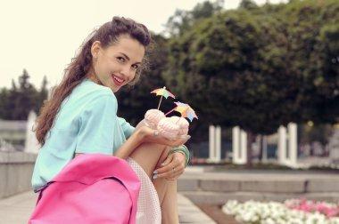 Woman holding three marshmallow