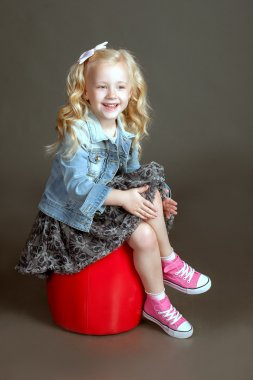 Little fashionista posing in denim suit