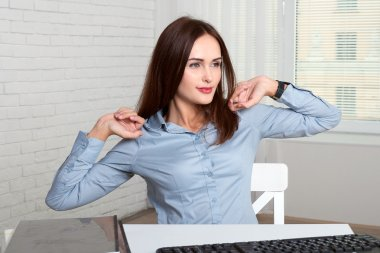 Girl secretary stretches himself tired from work