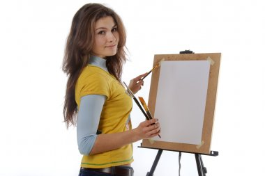 Girl artist draws on her easel