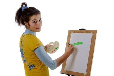 Girl artist draws on her the easel