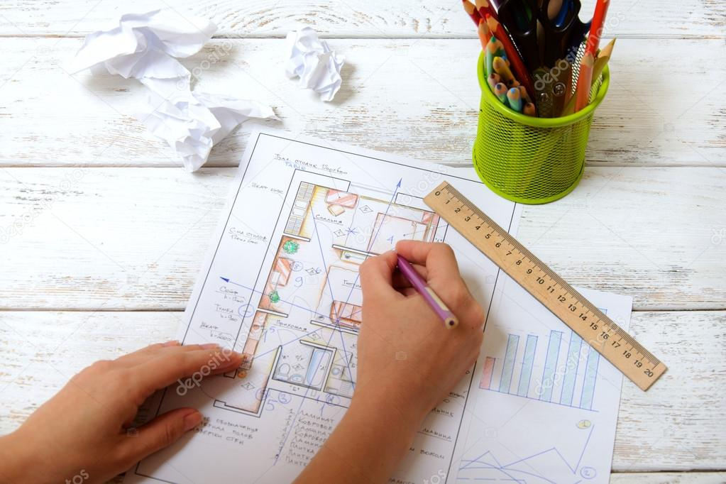 The woman draws a diagram of Feng Shui