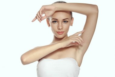 Girl raised her hands up and shows groomed armpits.