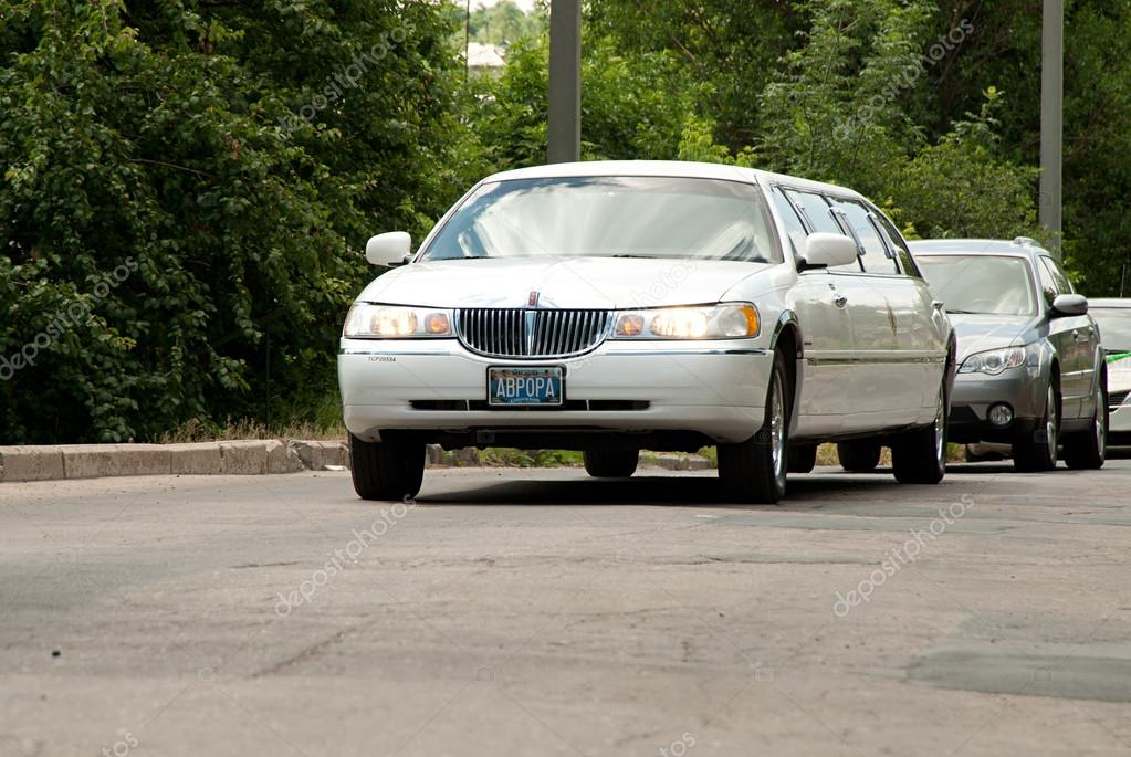 White Lincoln Town Car Limousine At The City Street Stock