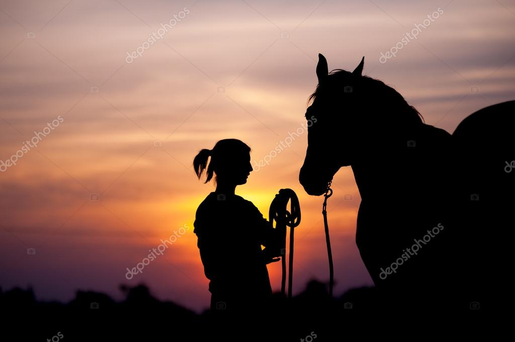 The girl near to a horse standing