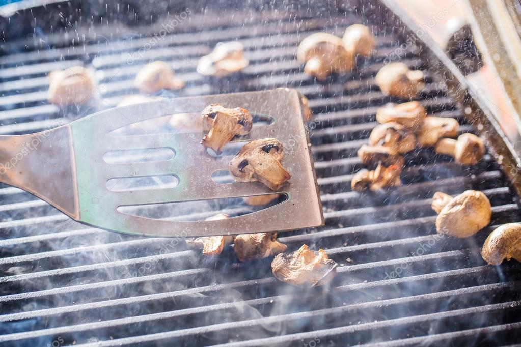 dce5402412f8 Champignon white mushrooms on spatula grilled on BBQ with steam and drops  of water — Photo by anclave