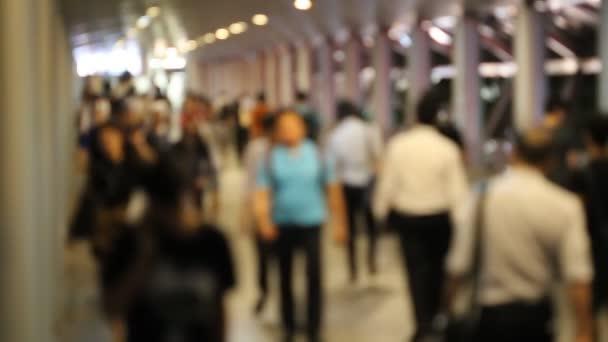 defocus men use smartphone call walk in crowd people at night