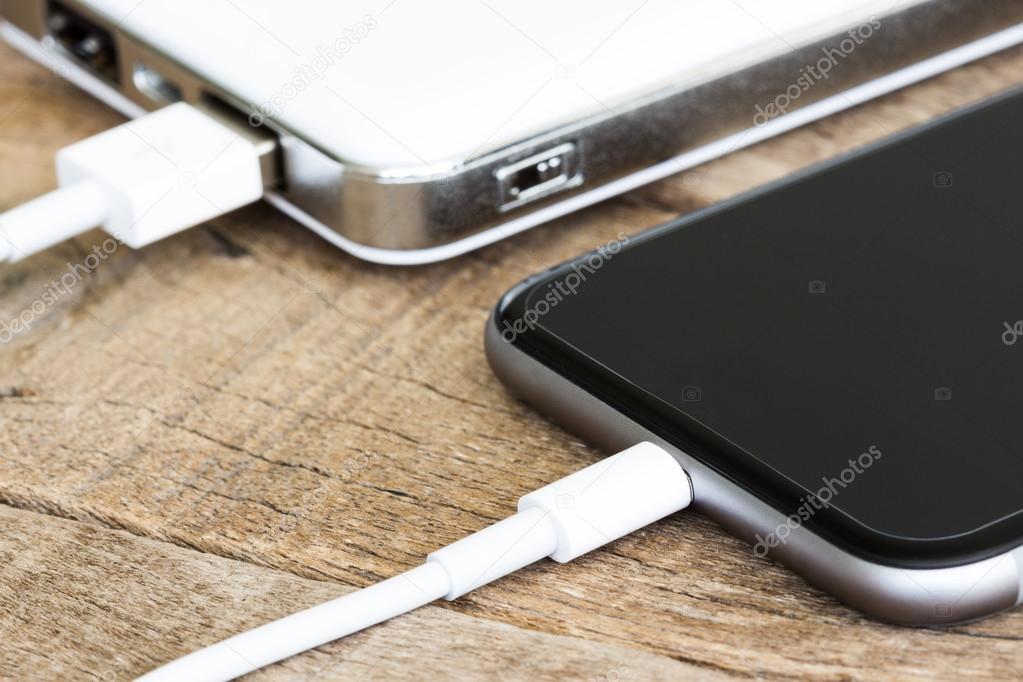 closeup phone charging white power bank portable devie