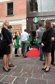 Hostesses and staff at opening of Starbucks in Mulhouse